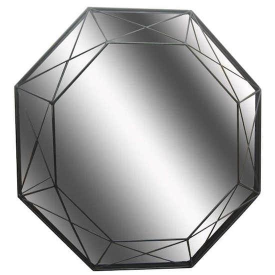 Miroir géométrique et tendance qui ajoute du charme à une chambre