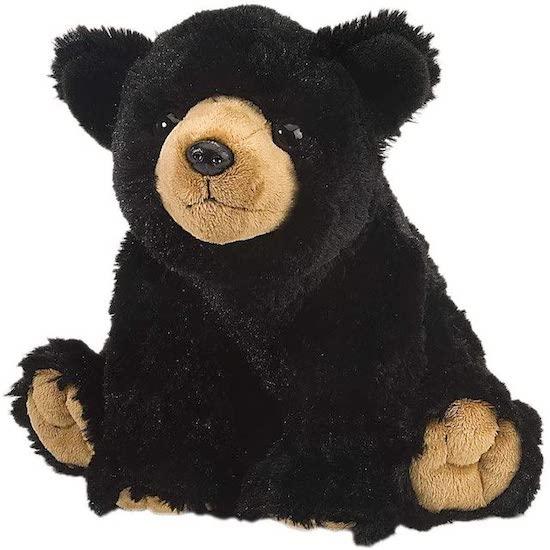 Peluche ours noir trop mignon dans une chambre d'enfant